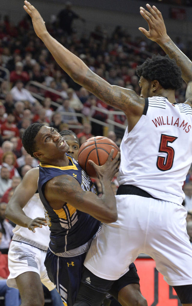 Kent State guard Jaylin Walker (23) attempts to fight his way through the defense of Louisville center Malik Williams (5) during the first half of an NCAA college basketball game in Louisville, Ky., Saturday, Dec. 15, 2018. (AP Photo/Timothy D. Easley)