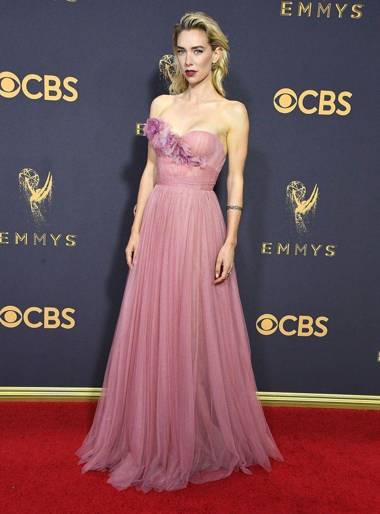 <p>Kirby stepped out for the Emmys in an elegant pink strapless Marchesa gown. She finished the look with a dark lip.</p>