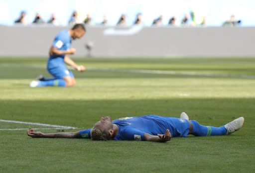 Brazil's Neymar lies on the pitch the in the penalty area during the group E match between Brazil and Costa Rica at the 2018 soccer World Cup in the St. Petersburg Stadium in St. Petersburg, Russia, Friday, June 22, 2018. (AP Photo/Petr David Josek)