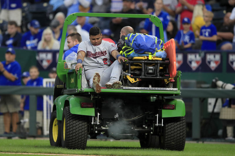 Minnesota Twins third baseman Luis Arraez (2) is taken from the game after an injury during the seventh inning of a baseball game against the Kansas City Royals at Kauffman Stadium in Kansas City, Mo., Saturday, Sept. 28, 2019. (AP Photo/Orlin Wagner)