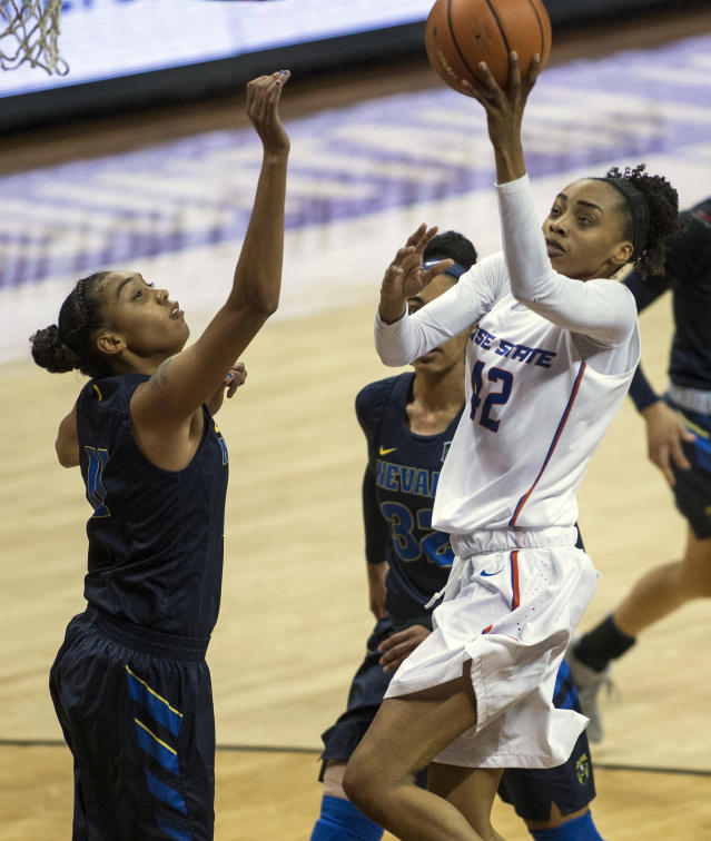 Boise State forward A'Shanti Coleman (42) elevates to the basket past Nevada defenders during the first half of an NCAA college basketball women's championship game in the Mountain West Conference tournament Friday, March 9, 2018, in Las Vegas. (AP Photo/L.E. Baskow)