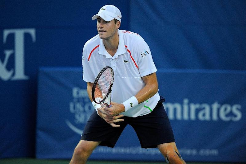 John Isner awaits a serve from Bradley Klahn during their Winston-Salem Open match North Carolina on August 19, 2014