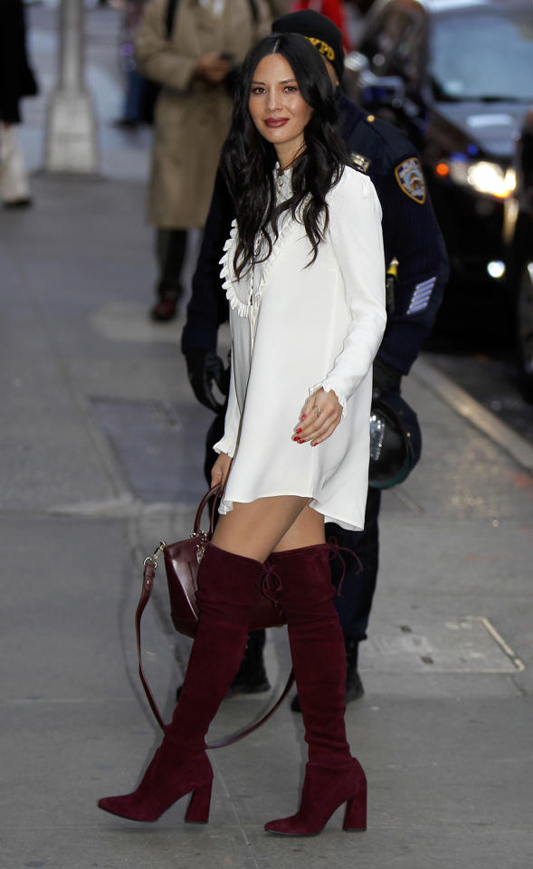 <p>Olivia Munn recently wore the Weitzman boots in bordeaux for an appearance on <em>Good Morning America.</em> <em>(Photo: Splash News)</em> </p>