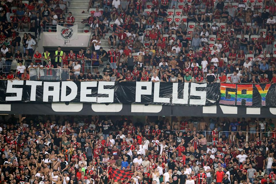 """Nice's supporters brandish a banner reading """"stadiums more gay,"""" just one of several homophobic banners that caused the suspension of the soccer match between OGC Nice and Olympique de Marseille. (VALERY HACHE/AFP/Getty Images)"""