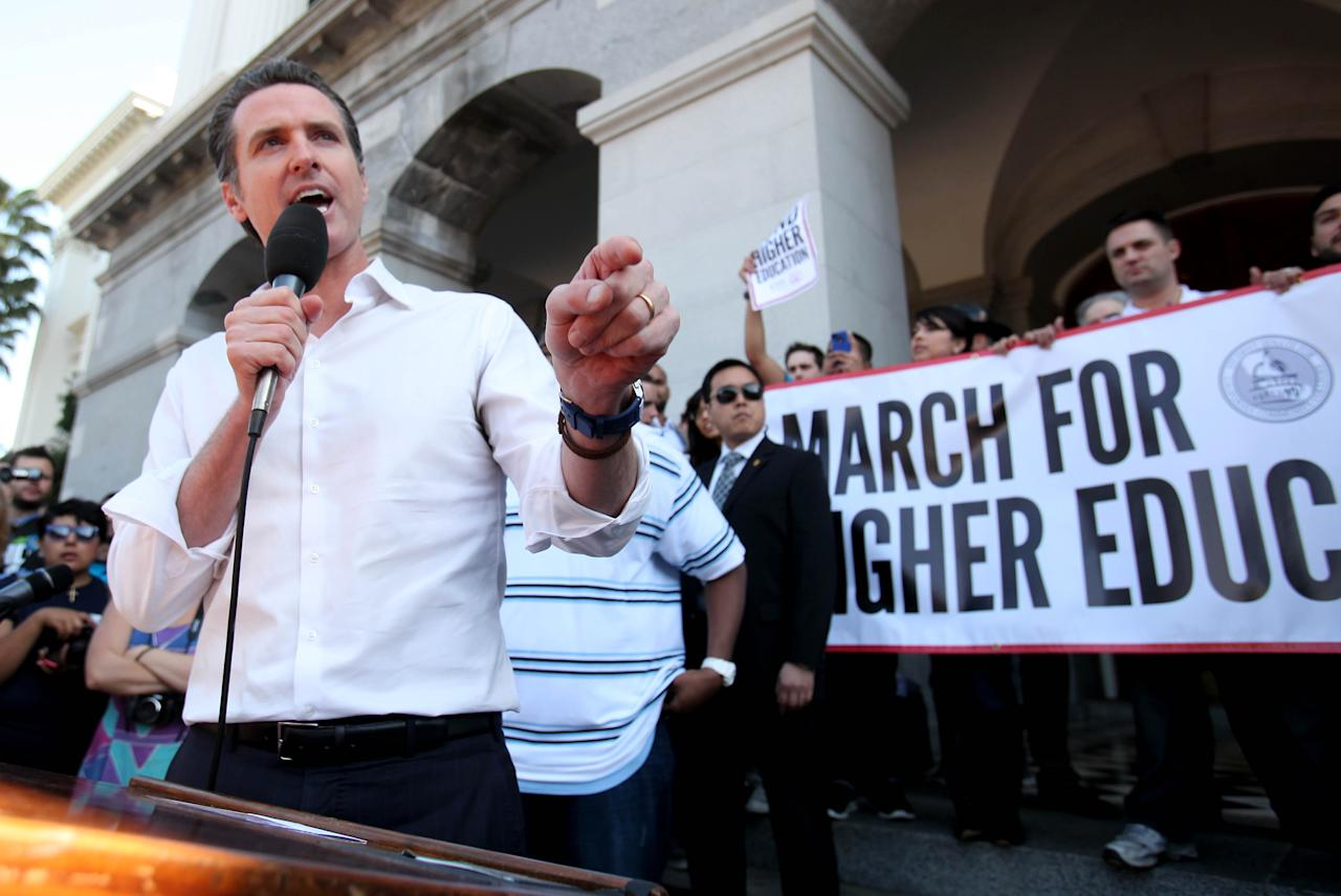 Lt. Gov. Gavin Newsom addresses a crowd of as many as 5,000 college students and supporters who marched to the Capitol to protest the rising cost of high education during a demonstration in Sacramento, Calif., Monday, March 5, 2012. Students, teachers and supporters from around the state converged on the Capitol to call on state lawmakers to restore funding for higher education.(AP Photo/Rich Pedroncelli)