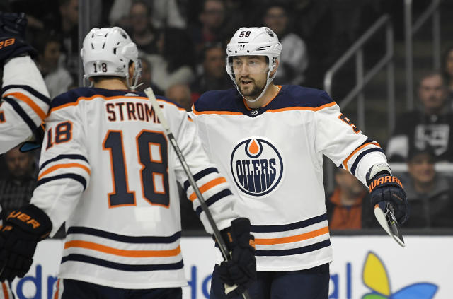 Edmonton Oilers left wing Anton Slepyshev, right, of Russia, celebrates his goal with center Ryan Strome during the first period of an NHL hockey game against the Los Angeles Kings, Saturday, Feb. 24, 2018, in Los Angeles. (AP Photo/Mark J. Terrill)