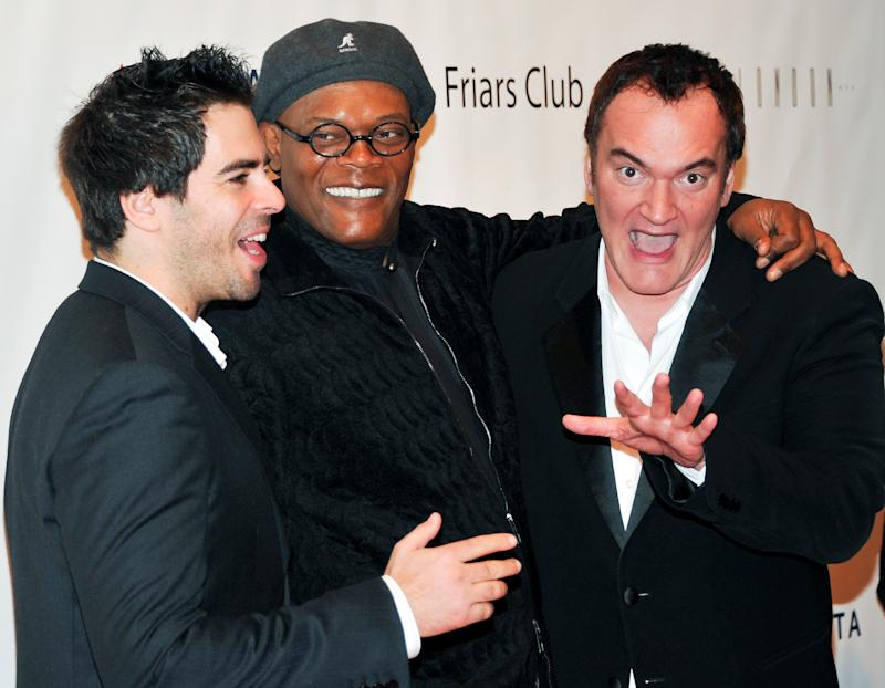 Actor Eli Roth, left, actor Samuel L. Jackson and director Quentin Tarantino, right, attend the Quentin Tarantino Friars Club Roast at the New York Hilton Hotel on Wednesday, Dec. 1, 2010 in New York. (AP Photo/Evan Agostini)