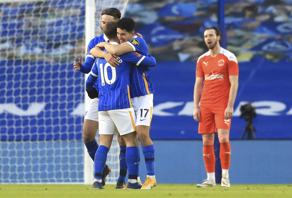 Brighton and Hove Albion's Steven Alzate celebrates scoring against Blackpool with teammates during the English FA Cup fourth round soccer match at The Amex, Brighton, England, Saturday Jan. 23, 2021. (Adam Davy/PA via AP)