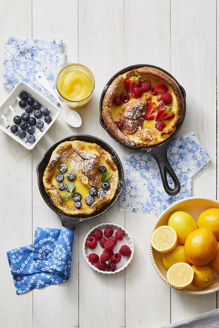 """<p>Don't let the size of these pancakes fool you. They are fluffy yet hardy, meaning you can pile on everything from berries to bacon.</p><p><em><strong><a href=""""https://www.womansday.com/food-recipes/a32291688/dutch-babies-recipe/"""" rel=""""nofollow noopener"""" target=""""_blank"""" data-ylk=""""slk:Get the Dutch Babies recipe."""" class=""""link rapid-noclick-resp"""">Get the Dutch Babies recipe. </a></strong></em></p>"""