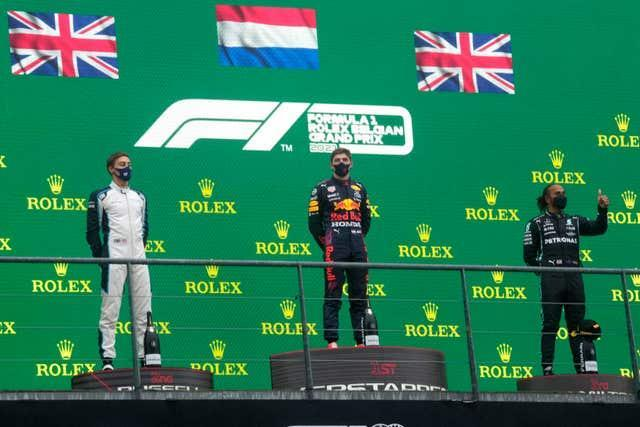 Max Verstappen topped the podium ahead of George Russell, left, and Lewis Hamilton, right (Francisco Seco/PA)