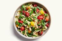 """This revamped pasta salad is bursting with fresh herbs and citrus, not mayo. Cherry tomatoes and charred sugar snap peas add sweetness. <a href=""""https://www.epicurious.com/recipes/food/views/pasta-salad-with-spring-vegetables-and-tomatoes?mbid=synd_yahoo_rss"""" rel=""""nofollow noopener"""" target=""""_blank"""" data-ylk=""""slk:See recipe."""" class=""""link rapid-noclick-resp"""">See recipe.</a>"""