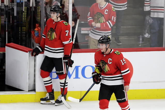 Chicago Blackhawks' Kirby Dach, left, and Jonathan Toews react after following the team's loss to the Arizona Coyotes in an NHL hockey game Sunday, Dec. 8, 2019, in Chicago. The Coyotes defeated the Blackhawks 4-3. (AP Photo/Nam Y. Huh)
