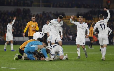 <span>Kenan Bajric's injury caused a lengthy delay at Molineux </span> <span>Credit: Getty Images </span>