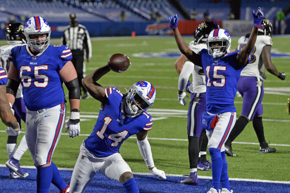 Buffalo Bills wide receiver Stefon Diggs (14) celebrates after scoring a touchdown during the second half of an NFL divisional round football game against the Baltimore Ravens Saturday, Jan. 16, 2021, in Orchard Park, N.Y. (AP Photo/Adrian Kraus)