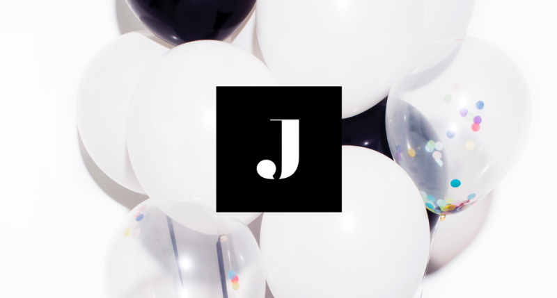 """The Jetblack """"J"""" logo in front of some balloons."""