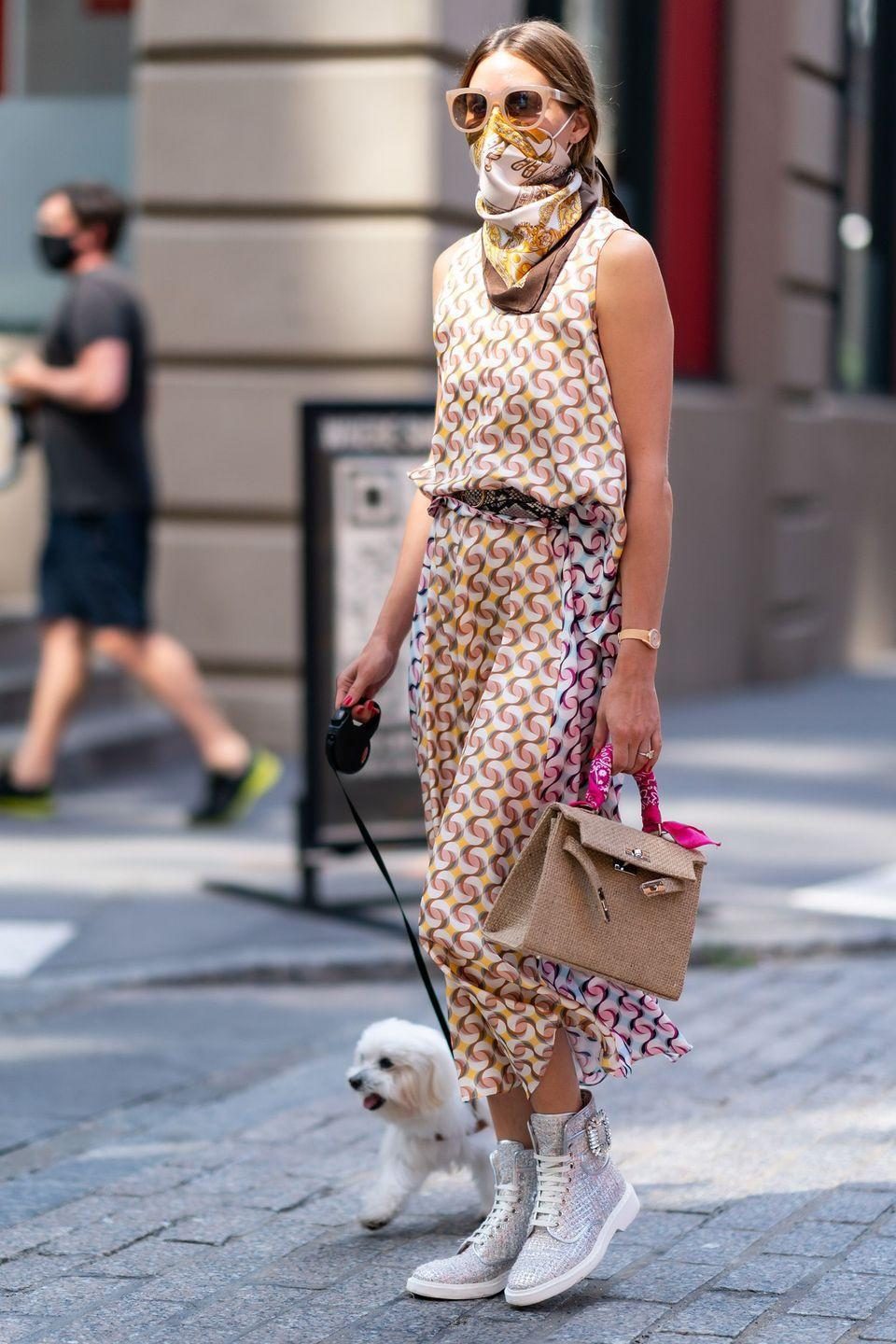 <p><strong>15 July </strong>Olivia Palermo was seen walking her dog in New York wearing a patterned ensemble with a co-ordinated face covering.</p>