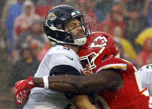 Ouch: Jacksonville QB Blake Bortles is hit by Chiefs' LB Justin Houston. (AP)