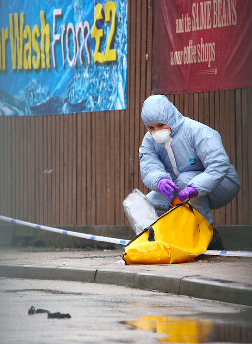 <em>Forensic teams are gathering evidence following the shooting (PA)</em>
