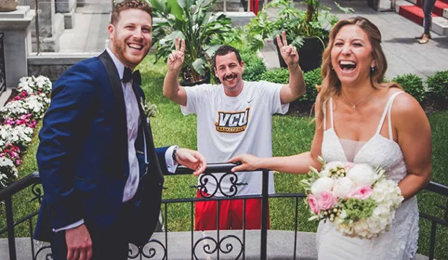 Adam Sandler throws up a double peace sign as he appears in this couple's wedding photo. (Photo: Mlle Sana Photography)
