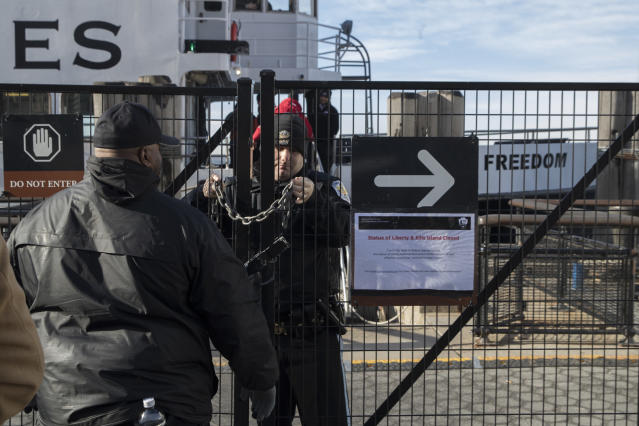 "<p>A United States Park Police officer, center, locks a gate leading to a Statue of Liberty ferry, Saturday, Jan. 20, 2018, in New York. The National Park Service announced that the Statue of Liberty and Ellis Island would be closed Saturday ""due to a lapse in appropriations."" Late Friday, the Senate failed to approve legislation to keep the government from shutting down after the midnight deadline. (Photo: Mary Altaffer/AP) </p>"