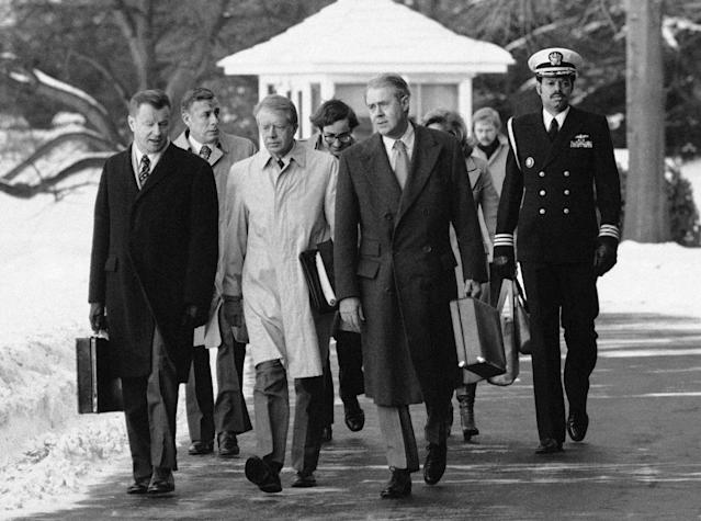 <p>President Jimmy Carter, flanked by Secretary of State Vance, right, and his advisor on foreign policy, Zbigniew Brzezinski, walked toward a waiting helicopter to fly to the nearby Andrews Air Force Base, Maryland, Feb. 14, 1979. The president is headed to Mexico for a 3-day visit. (Photo: Bob Daugherty/AP) </p>
