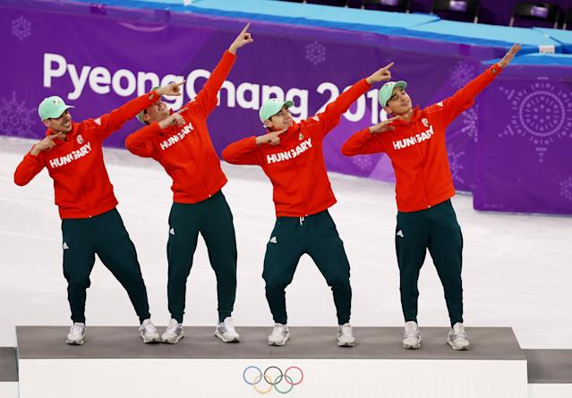 <p>Gold medalists Shaoang Liu, Shaolin Sandor Liu, Viktor Knoch and Csaba Burjan of Hungary celebrate during the victory ceremony after the Short Track Speed Skating Men's 5,000m Relay Final on day 13 of the PyeongChang 2018 Winter Olympic Games at Gangneung Ice Arena on February 22, 2018 in Gangneung, South Korea. (Photo by Ronald Martinez/Getty Images) </p>