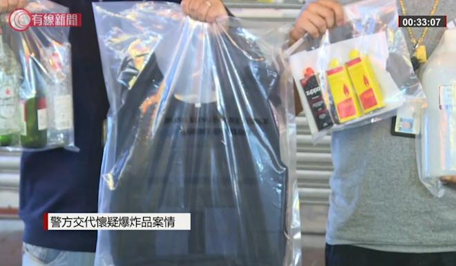 Police officers display some of the items recovered during the raid in Mong Kok. Photo: Handout