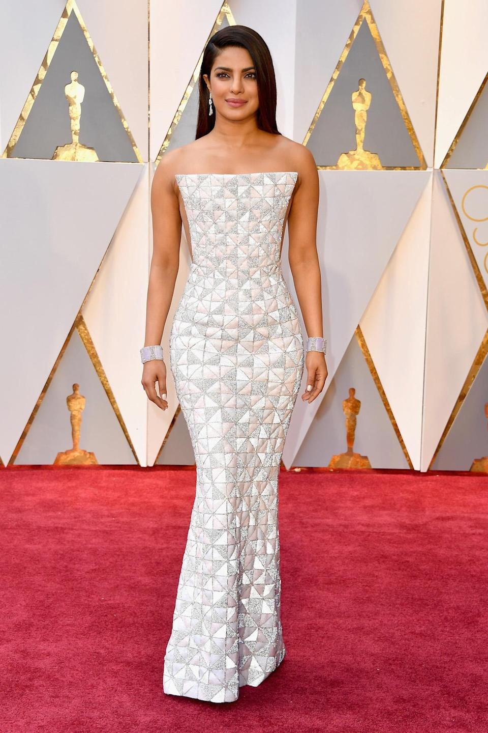 <p>Priyanka Chopra made a risky silhouette an A plus look thanks to impeccable tailoring, accessorizing, and stunning hair and makeup. <em>(Photo: Getty Images)</em> </p>