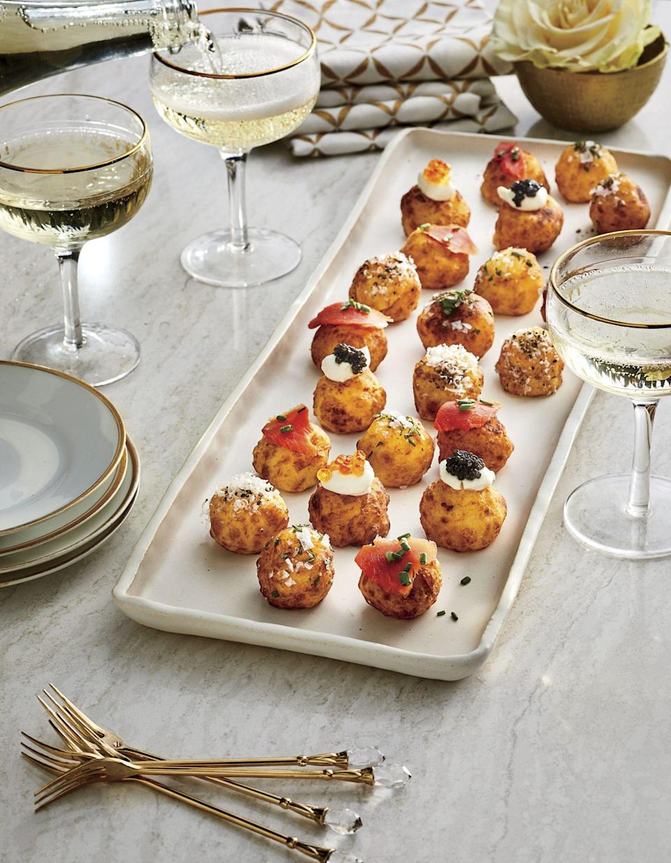 """<p><strong>Recipe: <a href=""""https://www.southernliving.com/recipes/potato-puffs"""" rel=""""nofollow noopener"""" target=""""_blank"""" data-ylk=""""slk:Potato Puffs with Toppings"""" class=""""link rapid-noclick-resp"""">Potato Puffs with Toppings</a></strong></p> <p>Think of these potato puffs as a party-ready version of tater tots. </p>"""