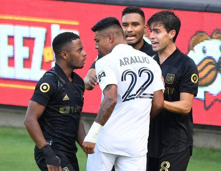 LOS ANGELES, CALIFORNIA AUGUST 22, 2020-Galaxy's Julian Araujo (22) gets in an argument with LAFS's Eddie Segura, left, in the 1st half at Banc of California Stadium in Los Angeles Saturday. (Wally Skalij/Los Angeles Times)