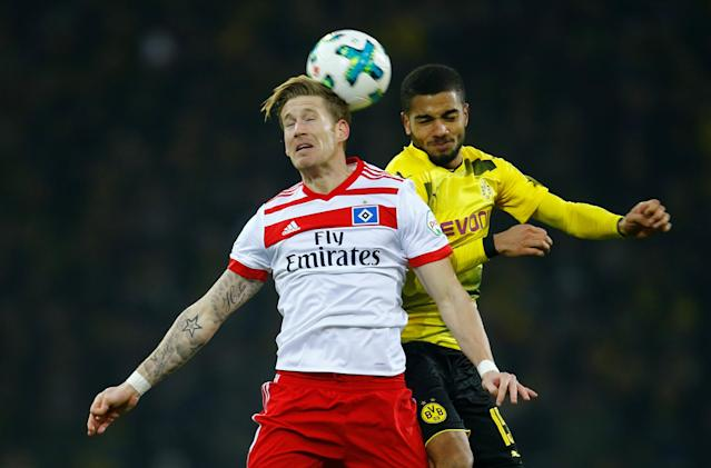 Soccer Football - Bundesliga - Borussia Dortmund vs Hamburger SV - Signal Iduna Park, Dortmund, Germany - February 10, 2018 Borussia Dortmund's Jeremy Toljan in action with Hamburg's Andre Hahn REUTERS/Leon Kuegeler DFL RULES TO LIMIT THE ONLINE USAGE DURING MATCH TIME TO 15 PICTURES PER GAME. IMAGE SEQUENCES TO SIMULATE VIDEO IS NOT ALLOWED AT ANY TIME. FOR FURTHER QUERIES PLEASE CONTACT DFL DIRECTLY AT + 49 69 650050