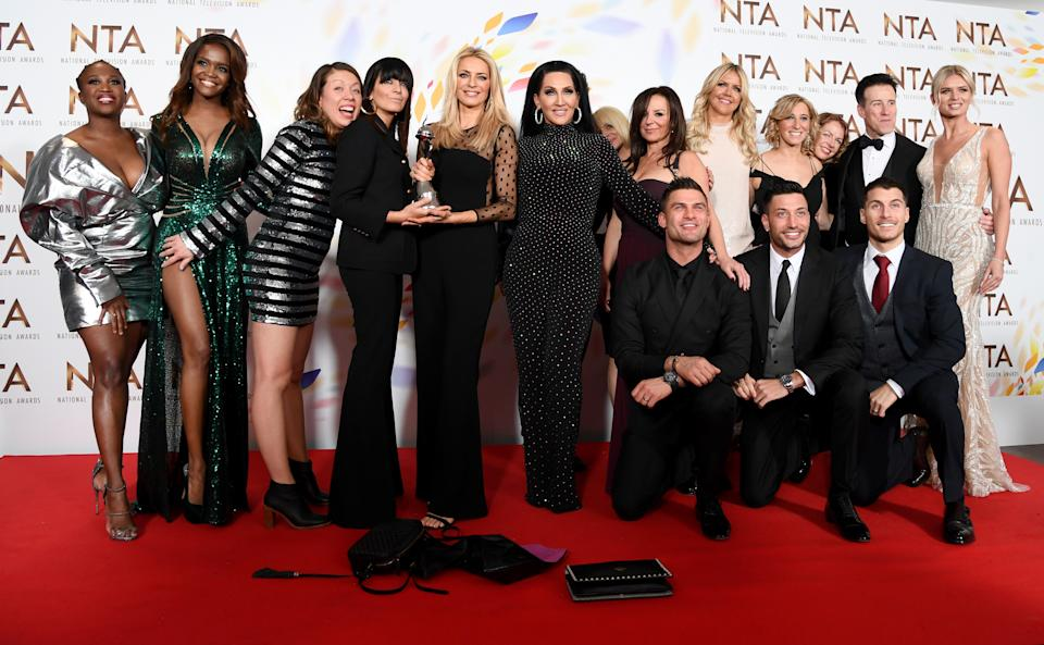 """LONDON, ENGLAND - JANUARY 28: Motsi Mabuse, Oti Mabuse, Claudia Winkleman, Tess Daly, Michelle Visage, Aljaz Skorjanec, Giovanni Pernice, Gorka Marquez, Anton du Beke and Nadiya Bychkova, accepting the Best Talent Show for """"Strictly Come Dancing"""", pose in the winners room during the National Television Awards 2020 at The O2 Arena on January 28, 2020 in London, England. (Photo by Gareth Cattermole/Getty Images)"""