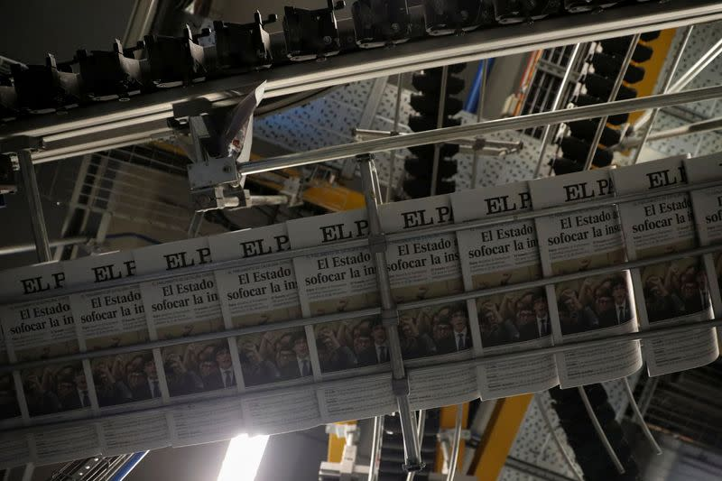 FILE PHOTO: Copies of El Pais newspaper showing Catalan President Puigdemont on its front page are seen in its printing press in Madrid