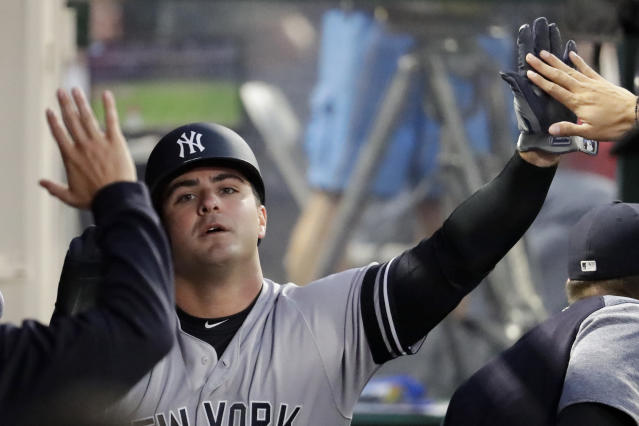 New York Yankees' Mike Ford celebrates in the dugout after scoring on a ball hit by Tyler Wade during the third inning of a baseball game against the Los Angeles Angels in Anaheim, Calif., Tuesday, April 23, 2019. (AP Photo/Chris Carlson)