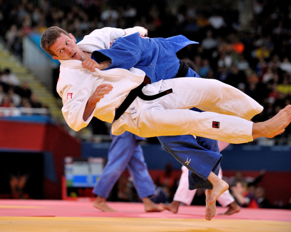 Nicolas Delpopolo of United States catches Dirk Van Tichelt of Belgium with a leg sweep to reach the quarter-finals in the Men's -73kg Judo on Day 3 of the London 2012 Olympic Games at ExCeL on July 30, 2012 in London, England. (Photo by David Finch/Getty Images)