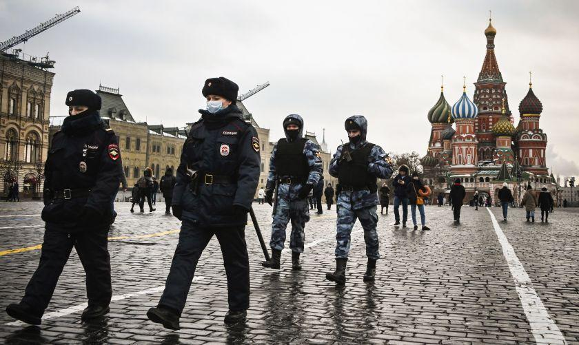 TOPSHOT - Police officers and the Russian National Guard (Rosgvardia) servicemen patrol on Red Square in central Moscow on January 25, 2021. - The Kremlin on Sunday accused the United States of interfering in Russia's domestic affairs and downplayed the scale of the weekend's protests, when tens of thousands rallied in support of jailed opposition politician Alexei Navalny. More than 3,500 demonstrators were detained in protests across the country on Saturday, with several injured in clashes with police in Moscow, following Navalny's call to rally against President Vladimir Putin's 20-year rule. (Photo by Alexander NEMENOV / AFP) (Photo by ALEXANDER NEMENOV/AFP via Getty Images)