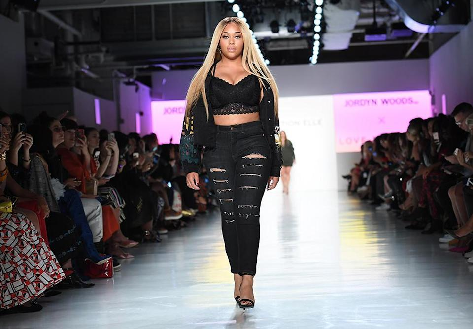 Jordyn Woods, who launched a collaborative line with Addition Elle, walks in the online retailer's NYFW runway show. (Photo: Getty Images)