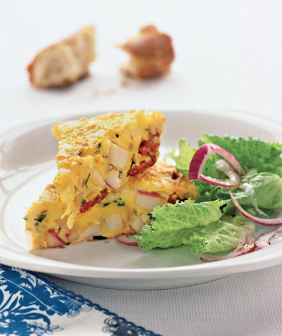 <p>Chorizo sausage spices up this classic Spanish egg dish—which can be made ahead and served at room temperature. </p>