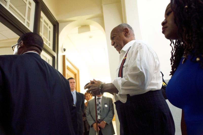 Cosby being taken into custody in handcuffs on Tuesday. (POOL via Getty Images)