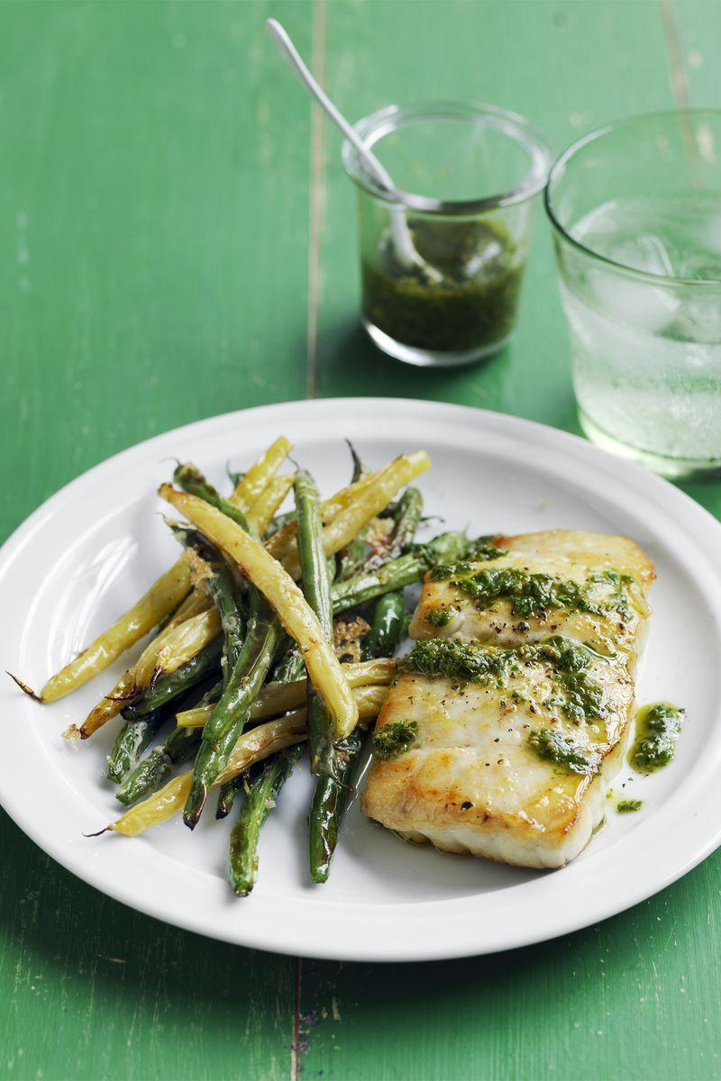 """<p>Freshen up your dinner repertoire with pan-seared fish and pesto.</p><p><a href=""""https://www.womansday.com/food-recipes/food-drinks/recipes/a55777/cod-with-crispy-green-beans-recipe/"""" rel=""""nofollow noopener"""" target=""""_blank"""" data-ylk=""""slk:Get the Cod with Crispy Green Beans recipe."""" class=""""link rapid-noclick-resp""""><em>Get the Cod with Crispy Green Beans recipe.</em></a></p>"""