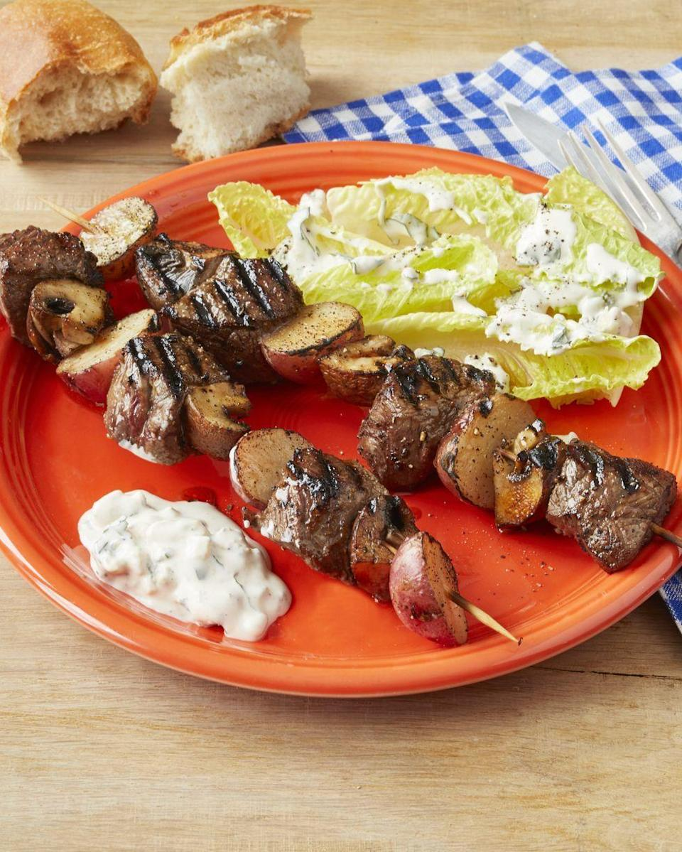 """<p>Give guests a taste of what's to come with these grilled steakhouse kebabs. Sour cream, vinegar, blue cheese, and Worcestershire sauce make for a dreamy dressing.</p><p><strong><a href=""""https://www.thepioneerwoman.com/food-cooking/recipes/a32433429/steakhouse-kebabs-recipe/"""" rel=""""nofollow noopener"""" target=""""_blank"""" data-ylk=""""slk:Get the recipe."""" class=""""link rapid-noclick-resp"""">Get the recipe.</a></strong></p><p><a class=""""link rapid-noclick-resp"""" href=""""https://go.redirectingat.com?id=74968X1596630&url=https%3A%2F%2Fwww.walmart.com%2Fip%2FThe-Pioneer-Woman-Vintage-Floral-4-Piece-Dinner-Plate-Set%2F55467844&sref=https%3A%2F%2Fwww.thepioneerwoman.com%2Ffood-cooking%2Fmeals-menus%2Fg32157273%2Ffourth-of-july-appetizers%2F"""" rel=""""nofollow noopener"""" target=""""_blank"""" data-ylk=""""slk:SHOP PLATES"""">SHOP PLATES </a></p>"""