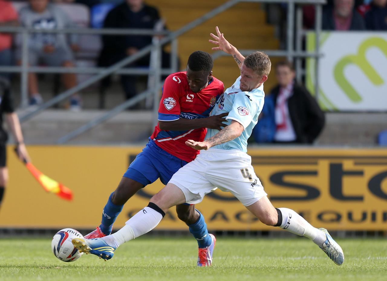Dagenham & Redbridge's Zavon Hines (left) is tackled by Exeter City's Scott Bennett during the Sky Bet Football League Two match at the London Borough of Barking and Dagenham Stadium, London.