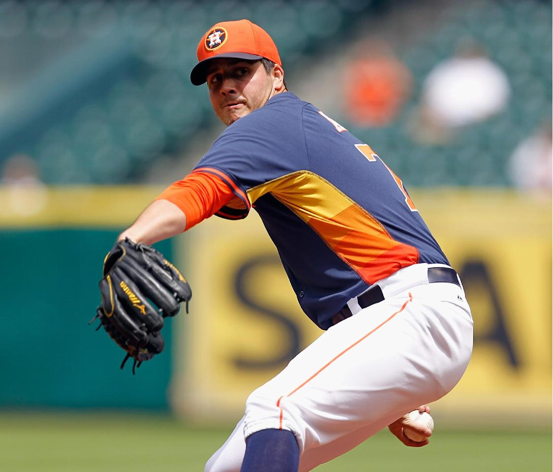 Houston Astros' Mark Appel throws in the first inning of a spring exhibition baseball game against Rojos del Aguila de Veracruz on Sunday, March 30, 2014, in Houston. (AP Photo/Bob Levey)