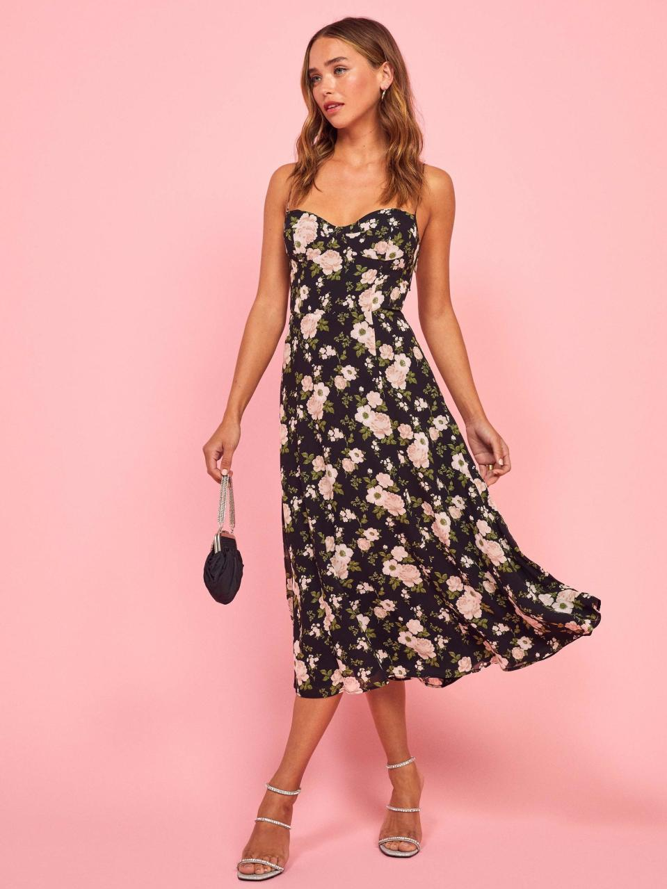 "<p><a href=""https://www.popsugar.com/buy/Reformation-Evangelista-Dress-552339?p_name=Reformation%20Evangelista%20Dress&retailer=thereformation.com&pid=552339&price=218&evar1=fab%3Aus&evar9=45873724&evar98=https%3A%2F%2Fwww.popsugar.com%2Ffashion%2Fphoto-gallery%2F45873724%2Fimage%2F47262117%2FReformation-Evangelista-Dress&list1=shopping%2Cdresses%2Cspring%2Cflorals%2Cspring%20fashion&prop13=mobile&pdata=1"" class=""link rapid-noclick-resp"" rel=""nofollow noopener"" target=""_blank"" data-ylk=""slk:Reformation Evangelista Dress"">Reformation Evangelista Dress</a> ($218)</p>"