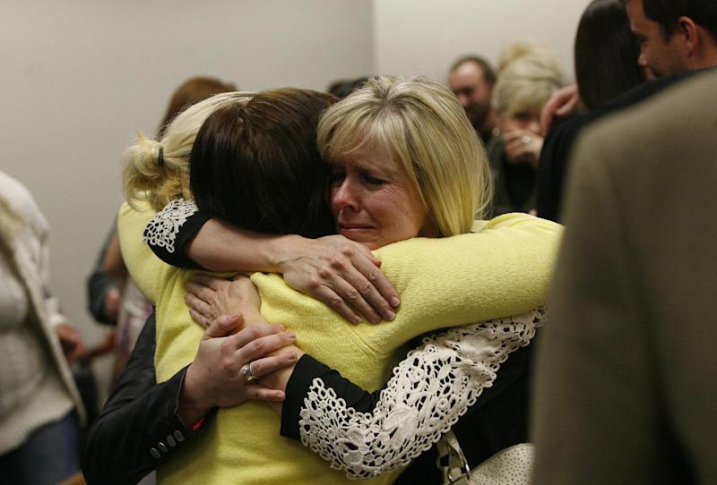 Linda Cluff, sister of Michelle MacNeill hugs friends after court was adjourned following the guilty verdict against Martin MacNeill. MacNeill was found guilty of murder and obstruction of justice early Saturday morning, Nov. 9, 2013. (AP Photo/The Salt Lake Tribune, Scott Sommerdorf)