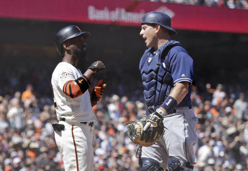 San Francisco Giants' Andrew McCutchen, left, argues with San Diego Padres catcher A.J. Ellis after being hit by a pitch during the seventh inning of a baseball game Saturday, June 23, 2018, in San Francisco. (AP Photo/Marcio Jose Sanchez)