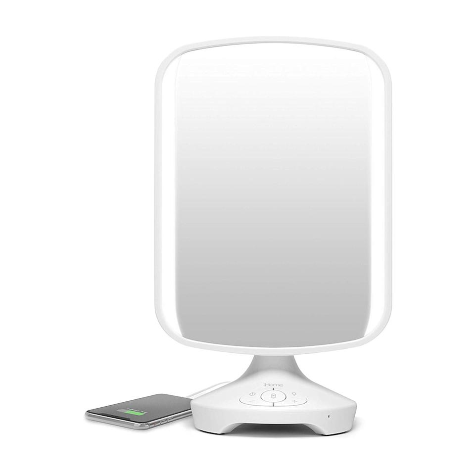 """I never thought I needed a lighted mirror…until I did. Not only does it do all these fancy things like charge my phone and play music while I'm applying mascara, but when you live in a studio with a partner who likes to take their time getting ready in the morning (and of course, <em>always</em> leaves the sink wet), having a vanity mirror makes a world of difference. <em>—Talia Abbas, commerce writer</em> $99, Amazon. <a href=""""https://www.amazon.com/iHome-iCVBT2-Adjustable-Hands-Free-Speakerphone/dp/B071Y4RMJS?"""">Get it now!</a>"""