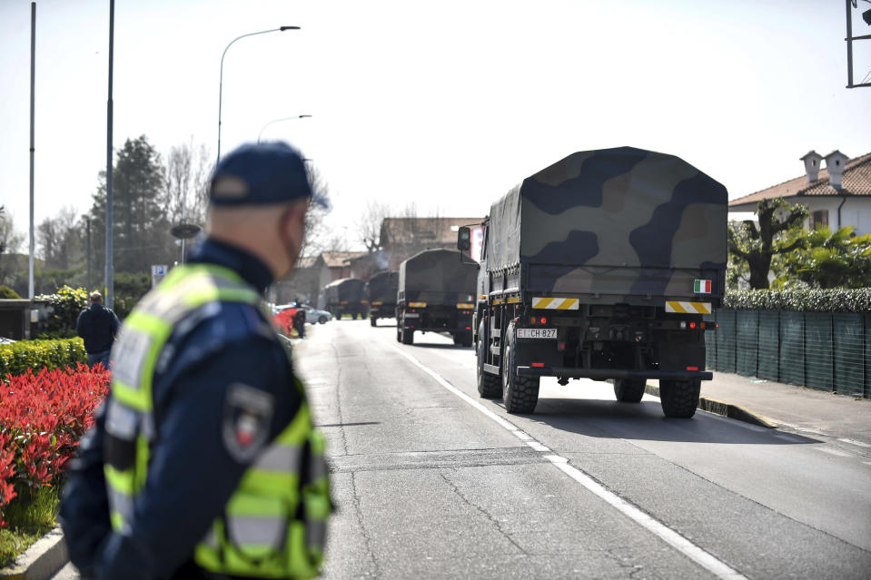 Military trucks carry coffins to be taken to crematoriums in Venice and Udine, from the San Giuseppe church in Seriate, near Bergamo, northern Italy, Saturday, March 28, 2020. The new coronavirus causes mild or moderate symptoms for most people, but for some, especially older adults and people with existing health problems, it can cause more severe illness or death. (Claudio Furlan/LaPresse via AP)