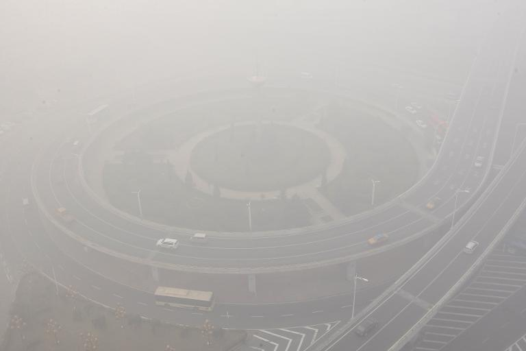 Streets and cars are seen under heavy smog in Harbin, northeast China's Heilongjiang province, on October 21, 2013