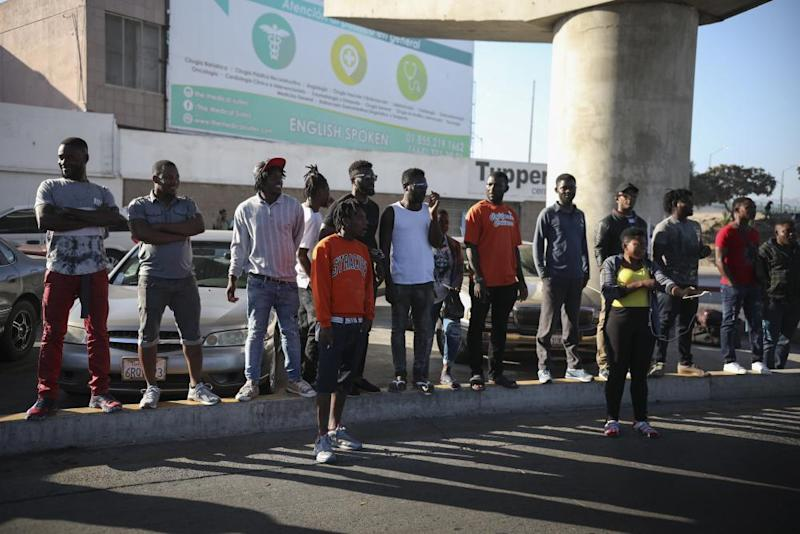 Migrants from Haiti and Africa wait to see if their number will be called to cross the border to apply for asylum in the US, in Tijuana.